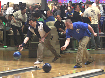 Two athletes competing at the State Bowling Tournament