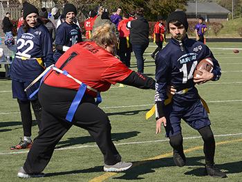 Runner avoids tackler at the 2019 State Flag Football Tournament