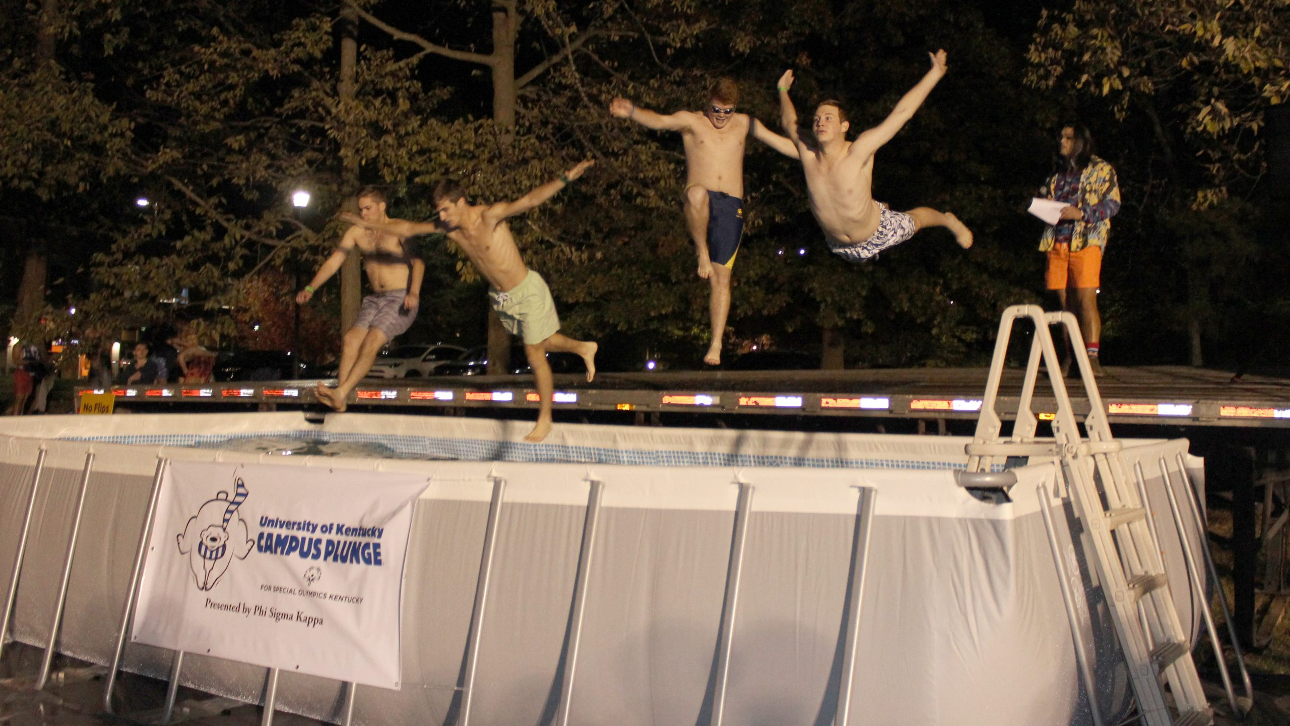 Students jump into a pool to take the Polar Plunge for Special Olympics on the University of Kentucky campus.